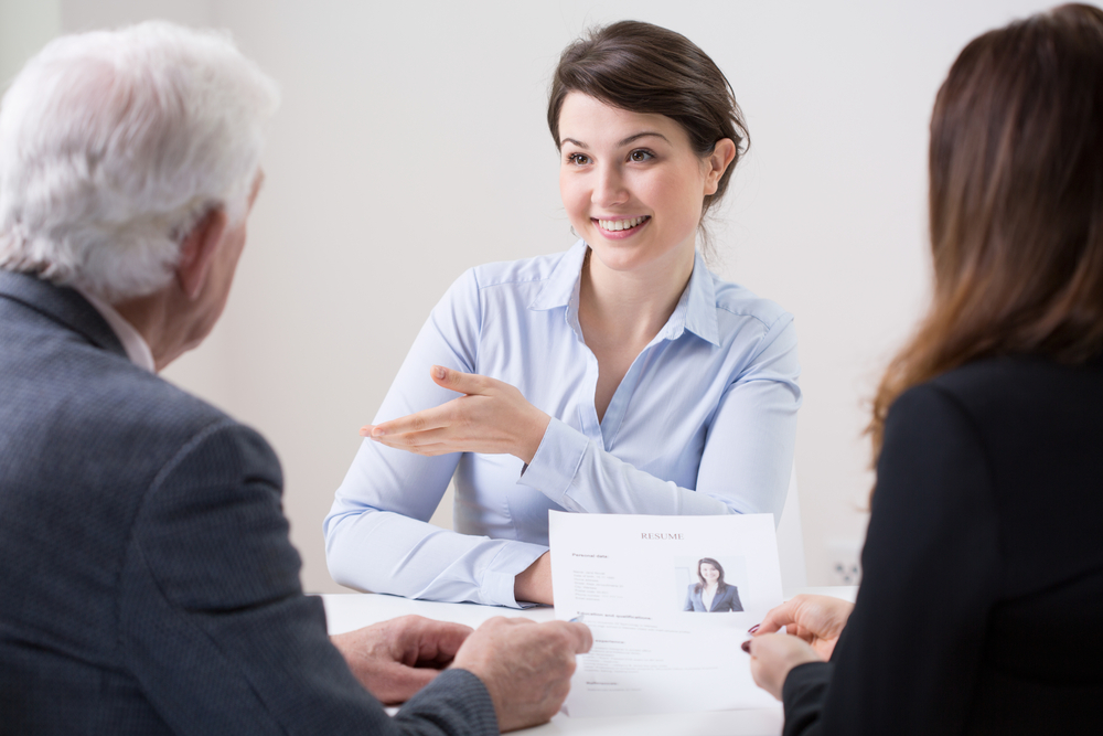 Human resources team during job interview with woman